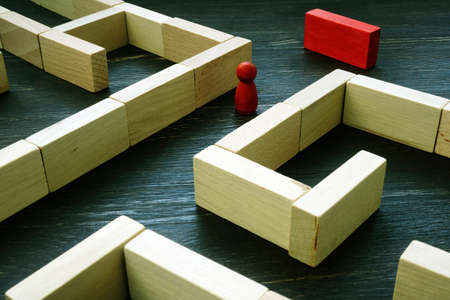 Figurine at the exit from the labyrinth as a concept for finding a solution to a problem.