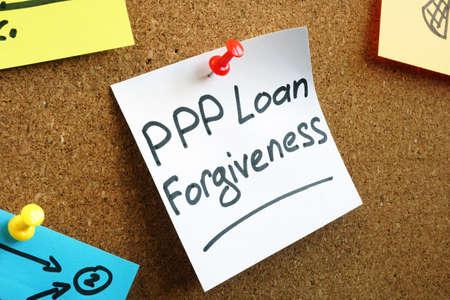 PPP loan forgiveness memo on the board.