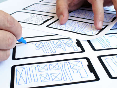 The UX UI designer develops the design of a mobile application.