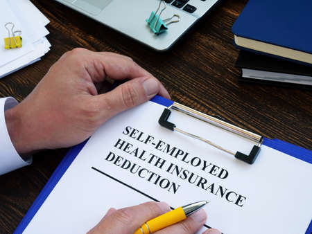 Self employed health insurance deduction application form for signing.