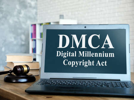 DMCA Digital Millennium Copyright Act on the laptop and gavel.