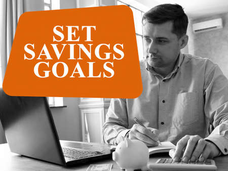 Set savings goals. The man is calculating home finances.