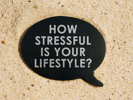 How stressful is your lifestyle. Black tablet on the sand. Imagens