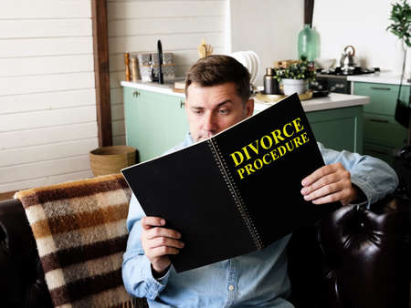 A man reading about Divorce procedure at home.