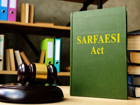 Sarfaesi act law and gavel in the office. Imagens