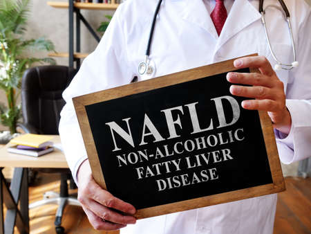 Non-alcoholic fatty liver disease NAFLD the doctor is holding a sign. Imagens