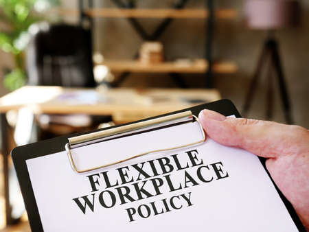 The manager is reading Flexible workplace policy in the office.