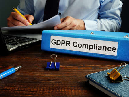GDPR compliance and man working with papers.