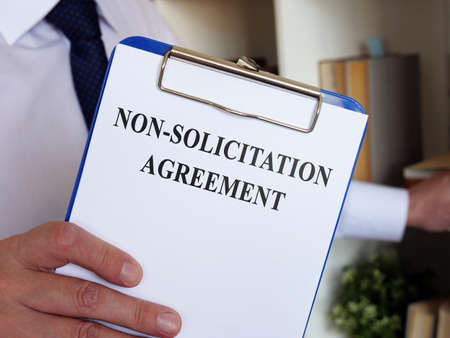 Non solicitation Agreement concept. The manager offers to sign the documents. Reklamní fotografie