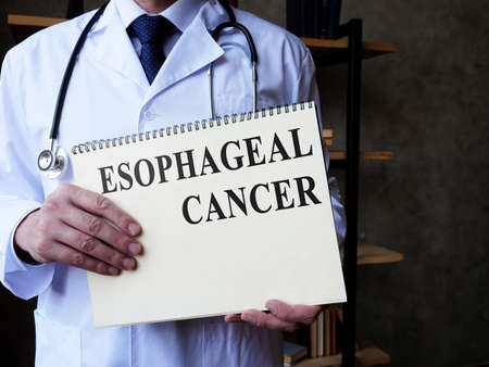 Esophageal cancer concept. Doctor holds medical papers.