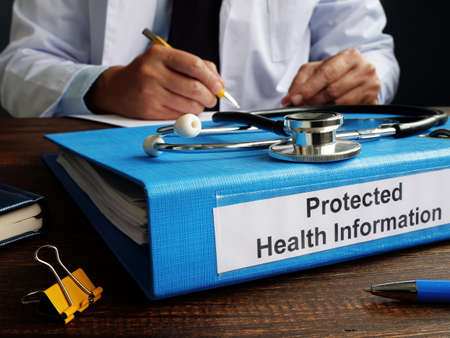 Folder with protected health information PHI as part of HIPAA rules. Reklamní fotografie