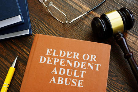 Elder or dependent adult abuse book and gavel.