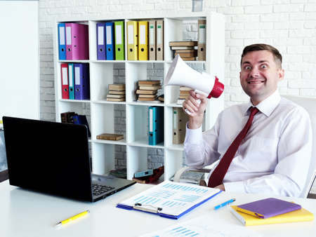 Thought leadership concept. Problems with bad boss. A man with a loudspeaker in the office. Reklamní fotografie