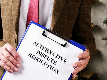 Lawyer offers documents alternative dispute resolution ADR and pen.