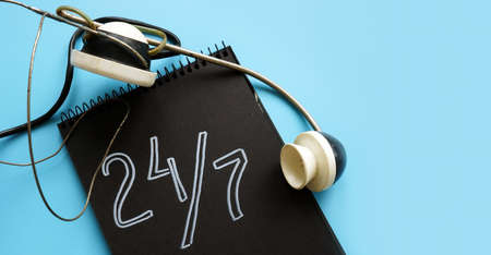 24 7 customer service and support concept and retro headset. Reklamní fotografie