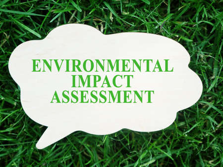 White plate with words Environmental impact assessment EIA.