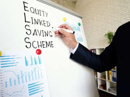 Businessman shows ELSS Funds Equity Linked Saving Scheme. Reklamní fotografie