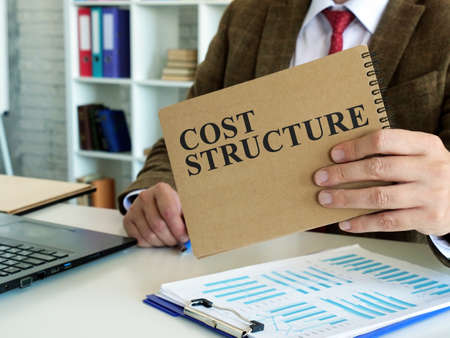 Cost structure concept. The manager makes financial calculations.