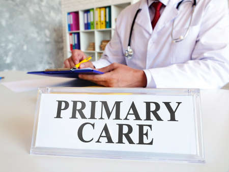 Primary care concept. The doctor writes down the medical history.