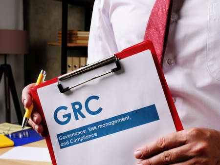 GRC Governance, risk management, and compliance document is in the hands of the manager.