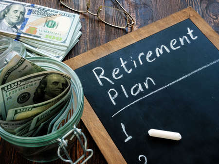 Cash and retirement plan hand written on a blackboard.