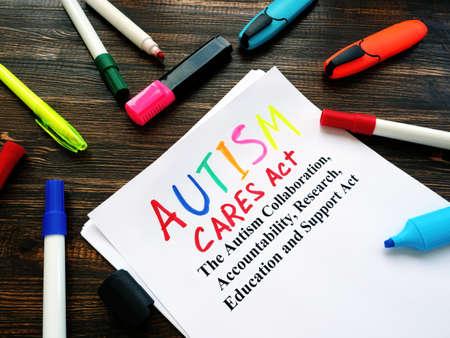 Autism CARES act. The Autism Collaboration, Accountability, Research, Education and Support Act papers on the desk.
