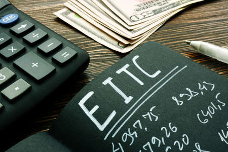 EITC Earned income tax credit calculations on the page. Reklamní fotografie