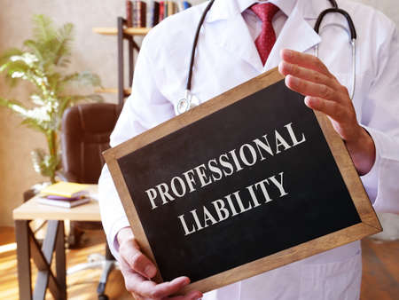 The doctor holds a sign with the Professional liability inscription.