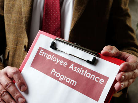 The manager offers Employee Assistance Program EAP papers.