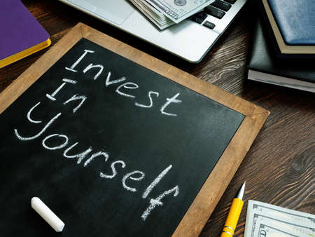 Invest in yourself memo on the blackboard.