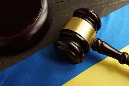 Ukrainian flag and gavel in the court as symbol of justice in Ukraine.