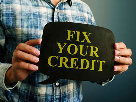 Fix your credit debt words on the wooden quote bulb.