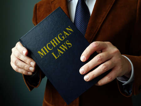 A Lawyer shows State Michigan law book.