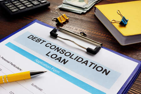 Debt consolidation loan form, notepad and calculator.