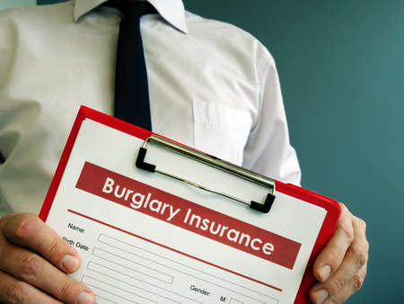 Empty Burglary insurance form with red clipboard.