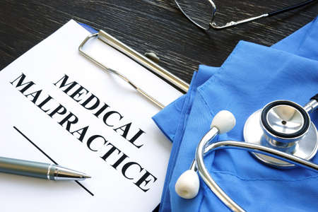 Medical malpractice. Medical suit, stethoscope and documents. Stock fotó