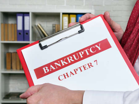 Clerk holds bankruptcy chapter 7 documents about insolvency.