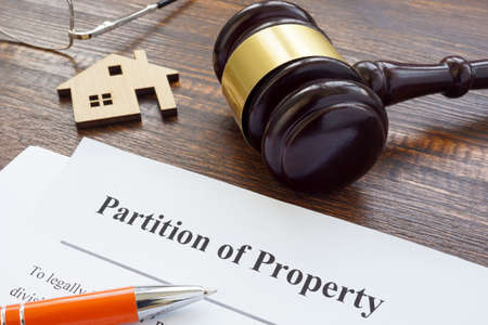 Partition of property agreement, gavel and house model.