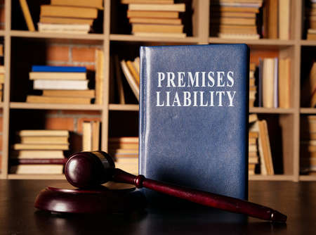 Premises Liability book with a court hummer.