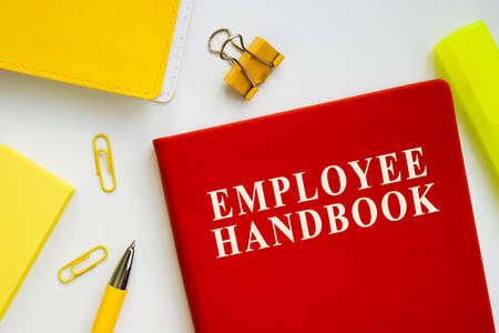 Employee handbook guide on the office desk.