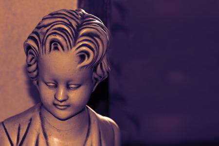 Sad statue, as a symbol of depression and despair.