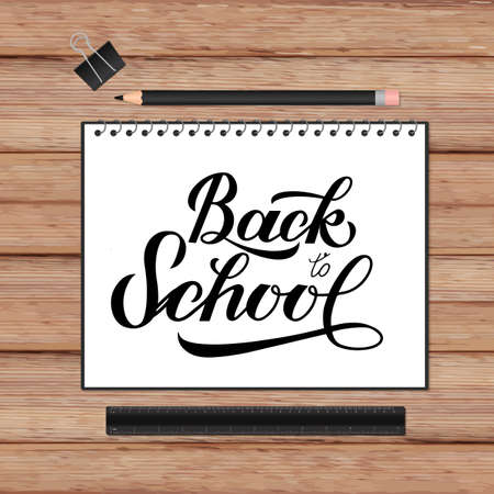 Back to school lettering hand written in a notebook. Wooden texture background and stationery. Vector template for advertising poster, logo design, banner, flyer, sign, greeting card, invitation, etc.
