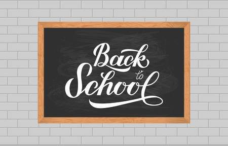 Chalkboard with wood frame on brick wall of classroom. Back to school calligraphy hand lettering.  Vector template for typography poster, logo design, banner, flyer, greeting card, sign, invitation. Stock Illustratie