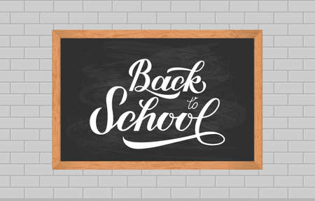 Chalkboard with wood frame on brick wall of classroom. Back to school calligraphy hand lettering.  Vector template for typography poster, logo design, banner, flyer, greeting card, sign, invitation. Banque d'images - 129255538