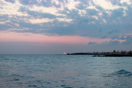 Sunrise over the sea in Kokkini Hani, Crete, Greece. Scenic seaside landscape in the morning.