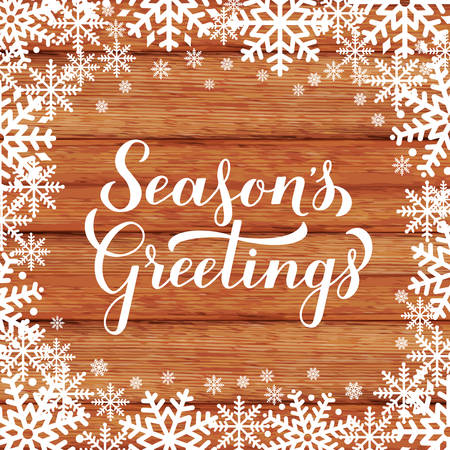 Season s Greetings calligraphy hand lettering on wood background with snowflakes. Merry Christmas and Happy New Year typography poster. Vector template for greeting card, banner, flyer, tag, etc.