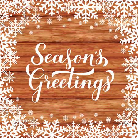 Temporada s Saludos caligrafía a mano letras sobre fondo de madera con copos de nieve. Cartel de tipografía de feliz Navidad y próspero año nuevo. Plantilla de vectores para tarjetas de felicitación, pancartas, folletos, etiquetas, etc.
