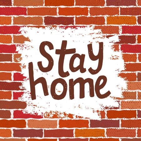 text Stay Home isolated on brick wall background. Handwriting lettering