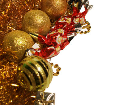 Holidays with gold tinsels, ball decorations, beadwork, christmas candy and small gift box.