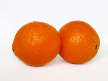 Two orange with water drops on white isolated background. Stock Photo
